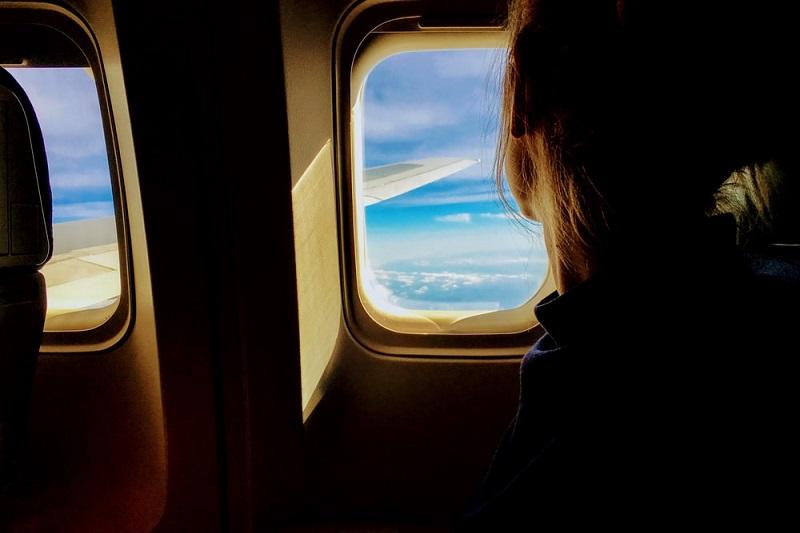 Mulher em voo para Maragogi